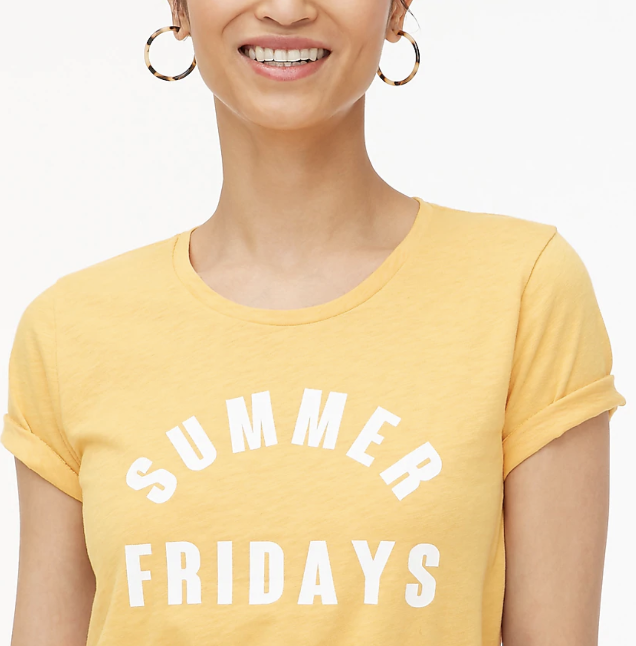 """A model wears a yellow T-shirt that says """"Summer Fridays"""""""