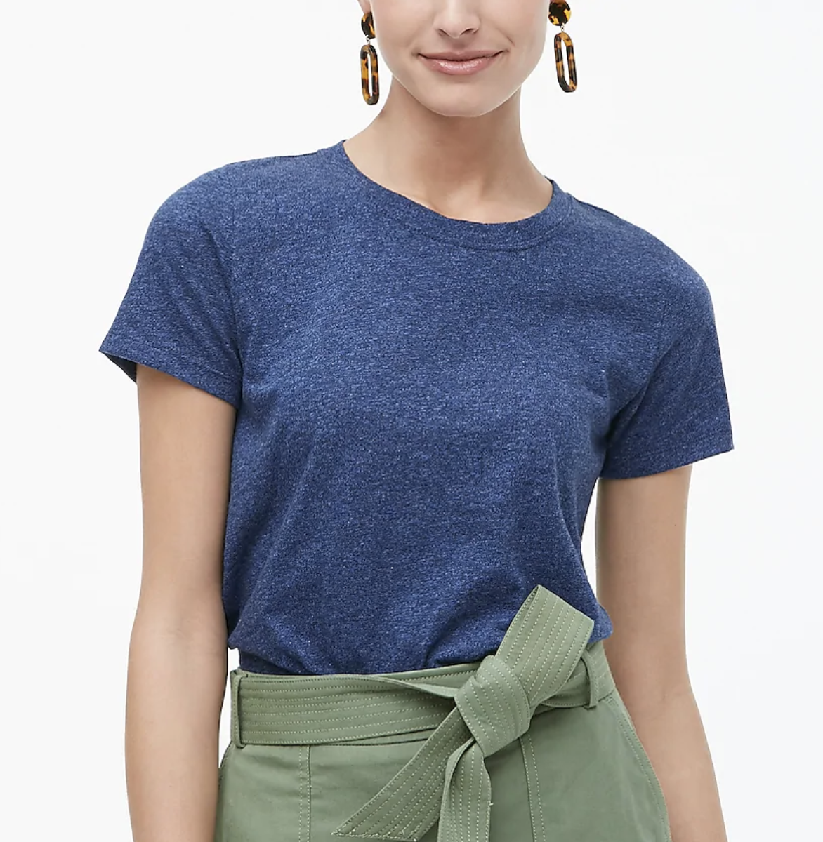 A model wears a dark blue  girlfriend crewneck tee with khaki pants