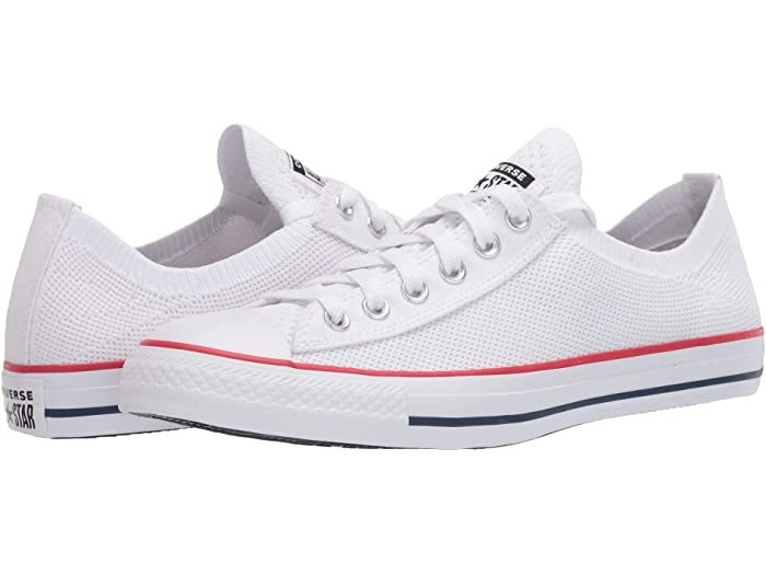 Converse in white with blue and red accent lines