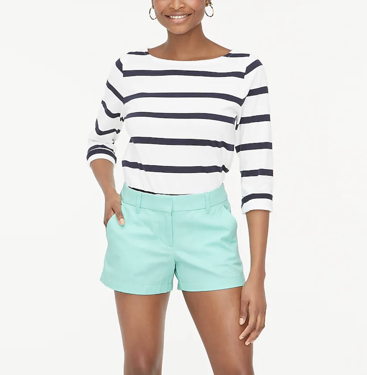 A model wears aqua classic chino shorts