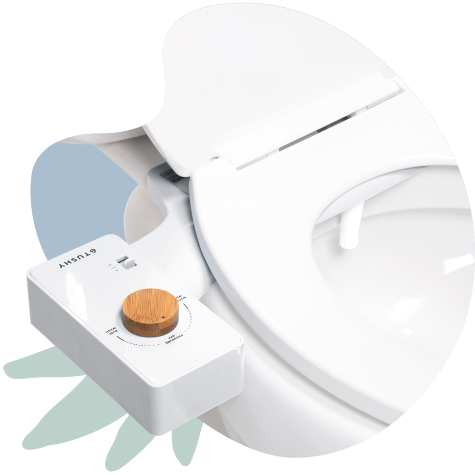 A bidet sitting beneath the toilet seat with a circular dial to change intensity