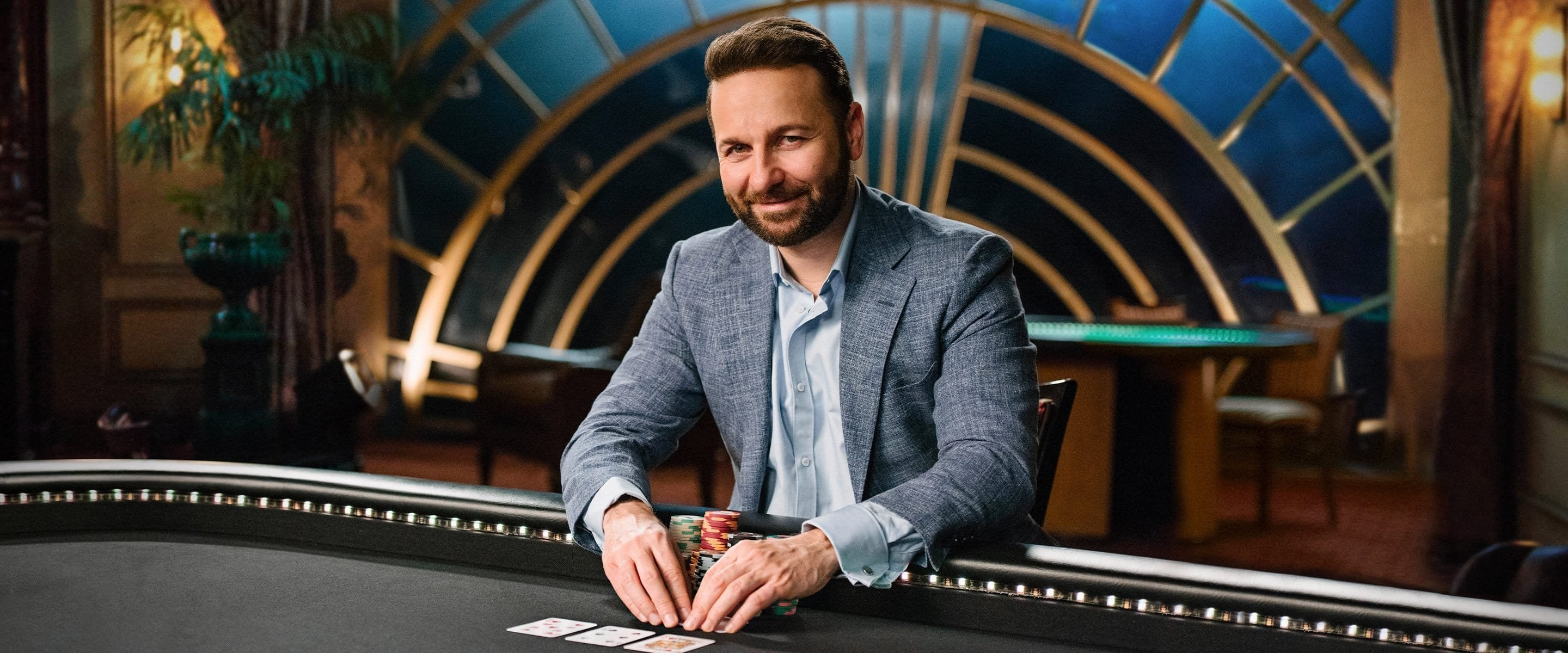 Course instructor Daniel Negreanu sitting at a poker table