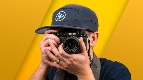 A person looking through a camera