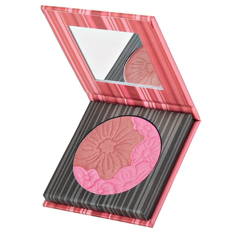 A circular pan with a bright pink blush and darker pink blush pressed together in a floral design