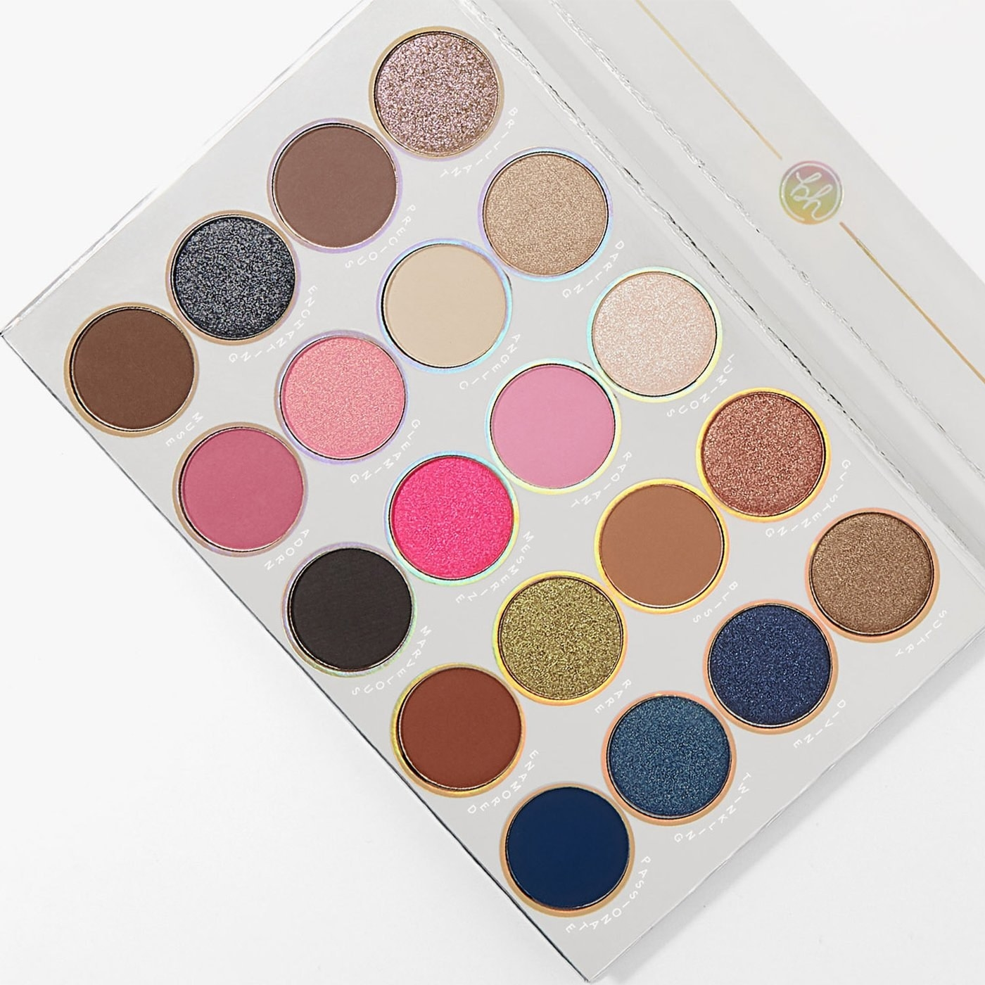 An open eyeshadow palette featuring 20 shades, including blues, browns, pinks, and neutrals