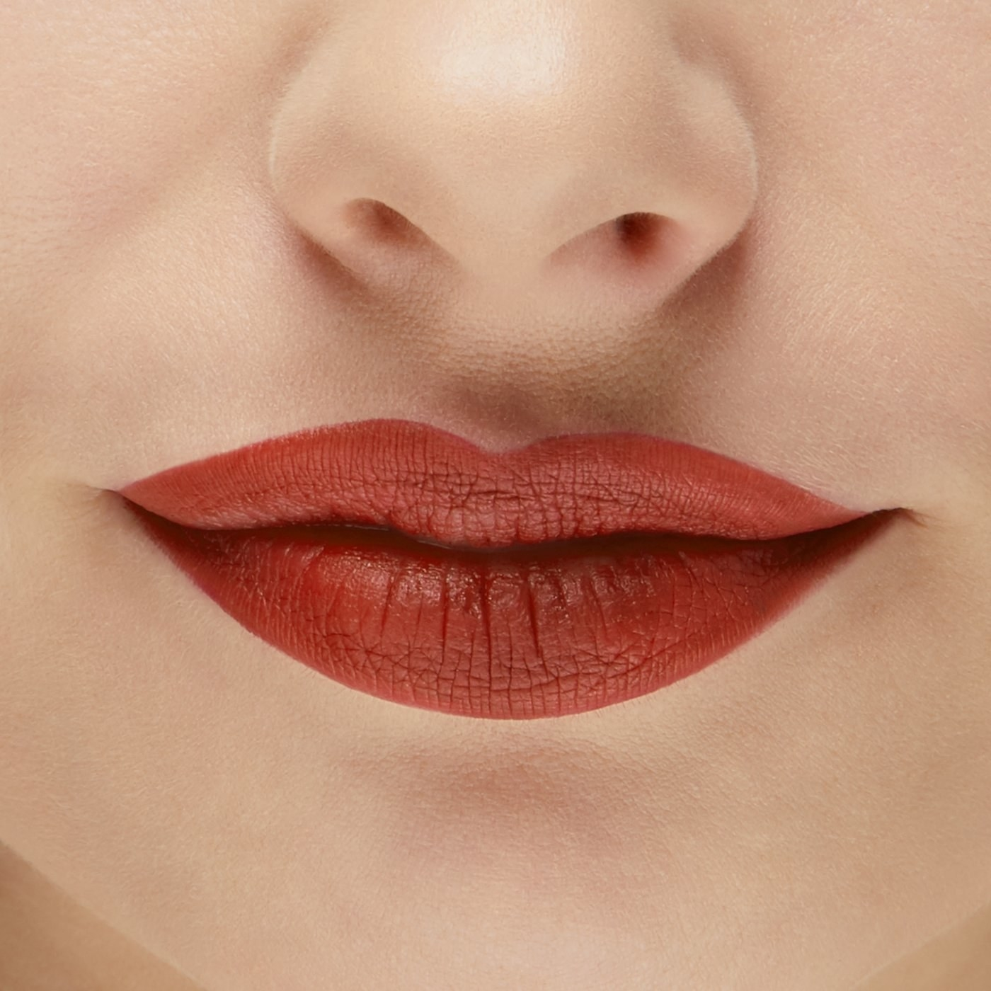 Lips wearing the orange-ish, brown-red lipstick shade