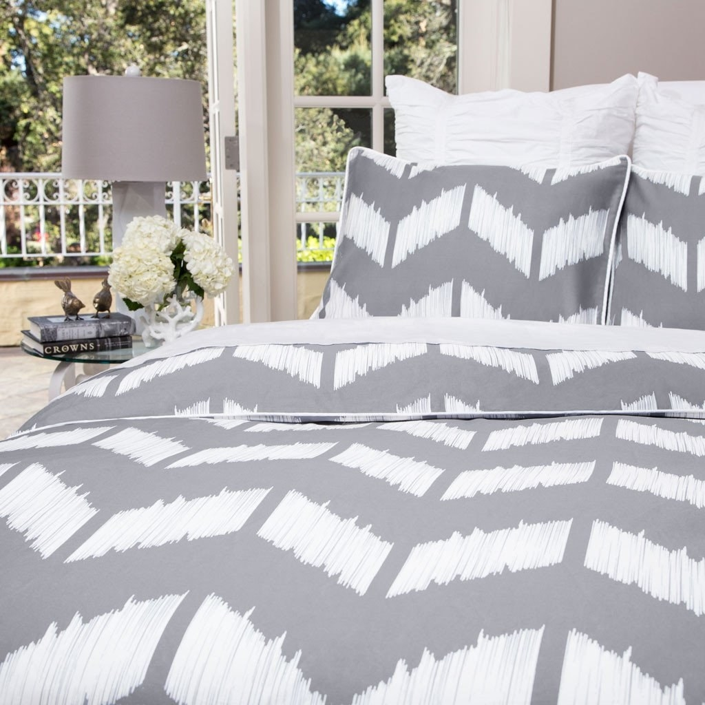 A grey and white chevron duvet set, staged on a bed