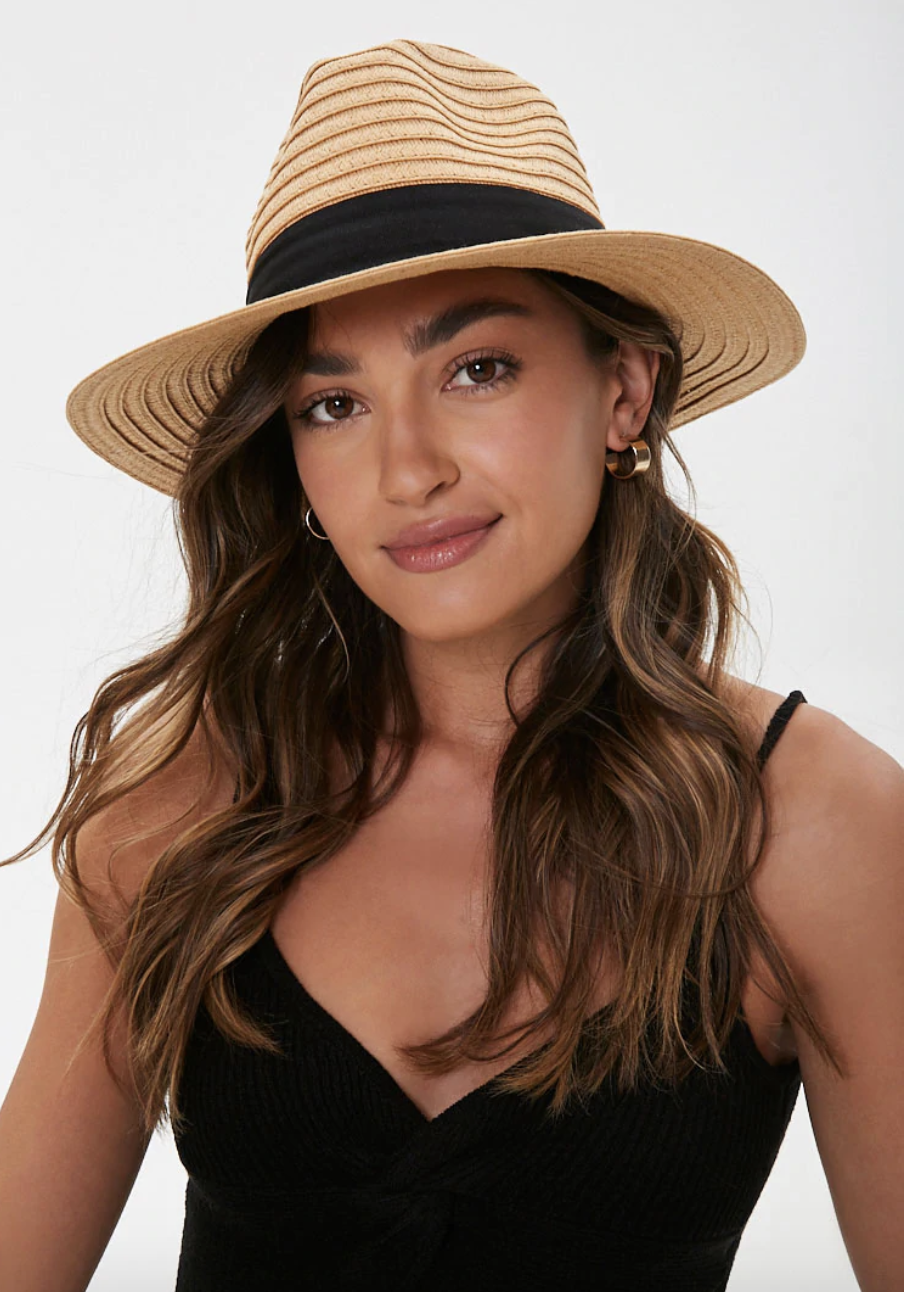 A model in the hat, which has a wide brim and black ribbon trim