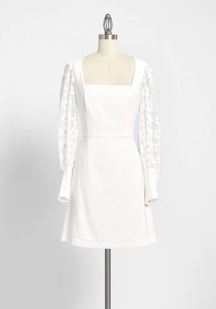the dress with mesh sleeves and flower appliques