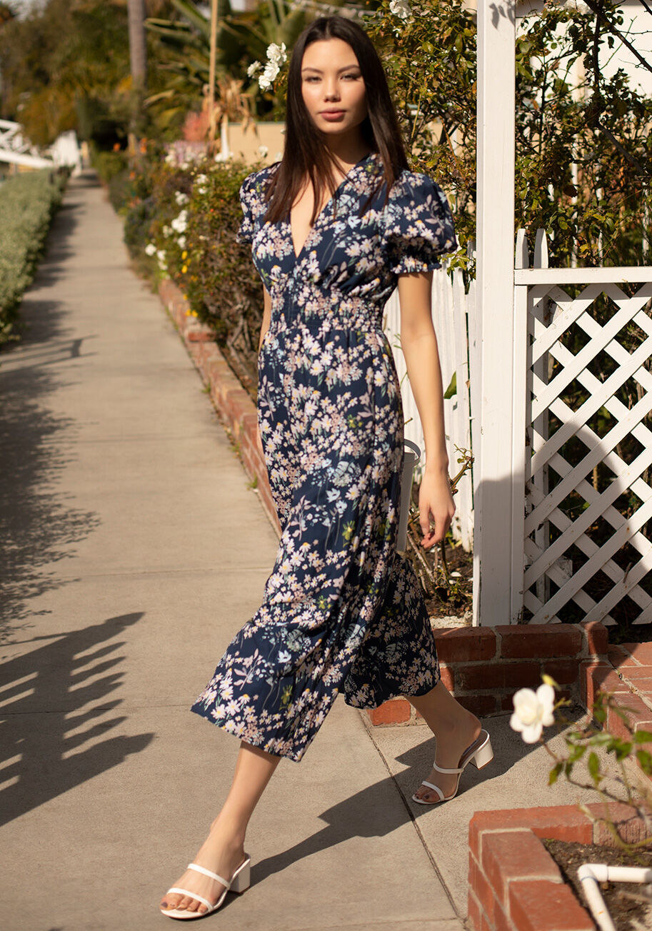 a model wearing a navy floral jumpsuit