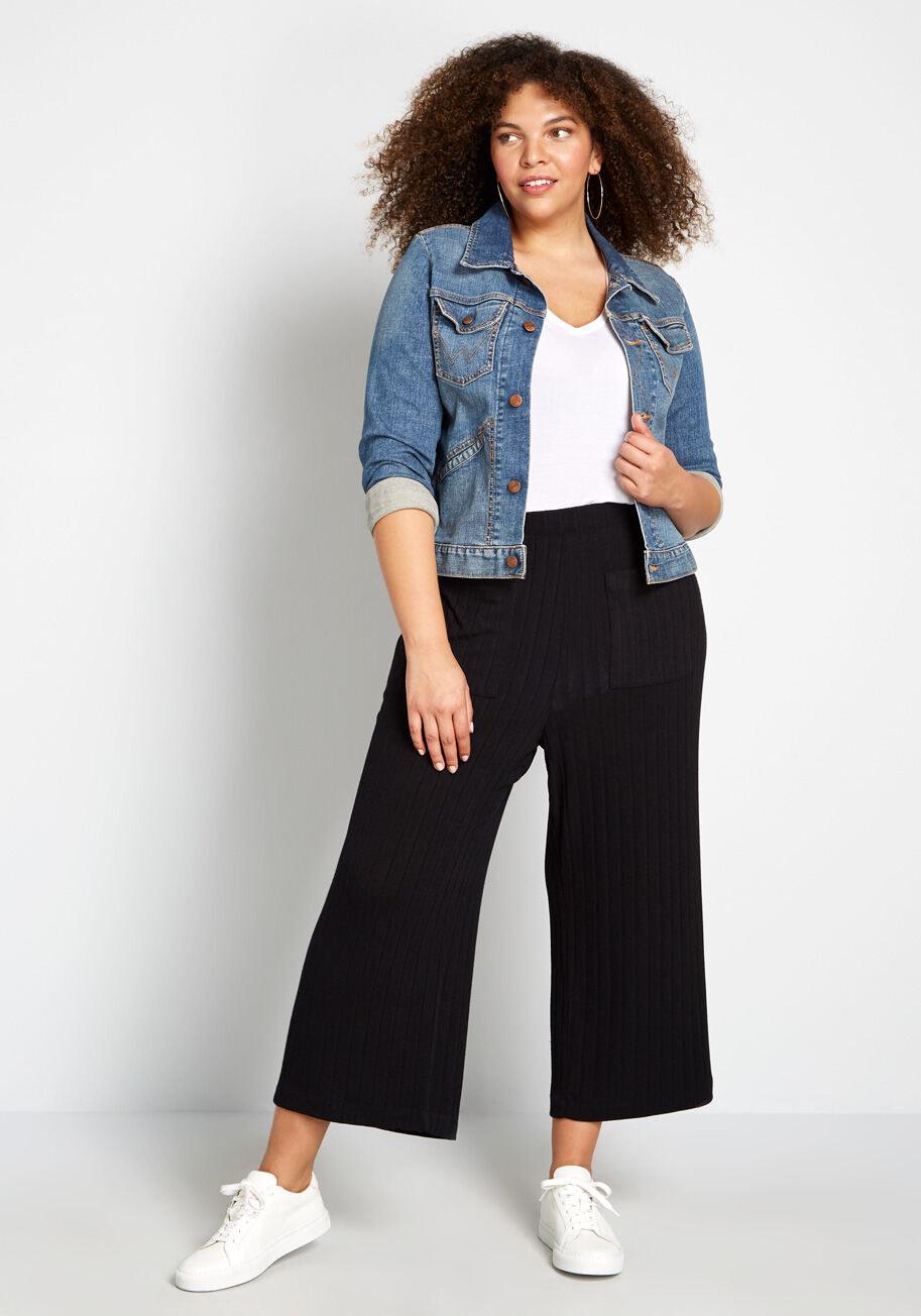 model wears the pants in black