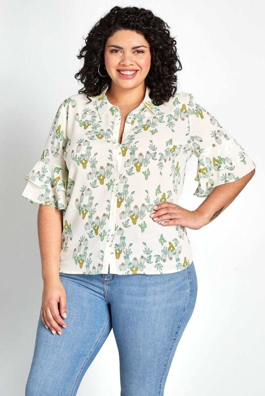A model wearing the shirt, which is collared with elbow-length sleeves