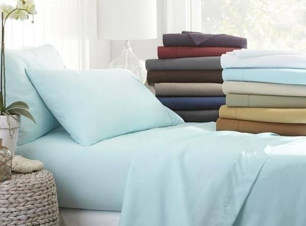 A display of bed sheets and pillow cases in various colors