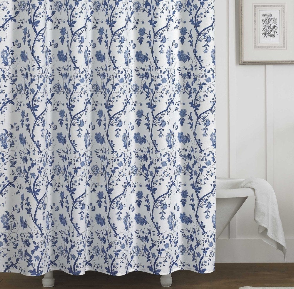 A white background shower curtain with a blue floral print