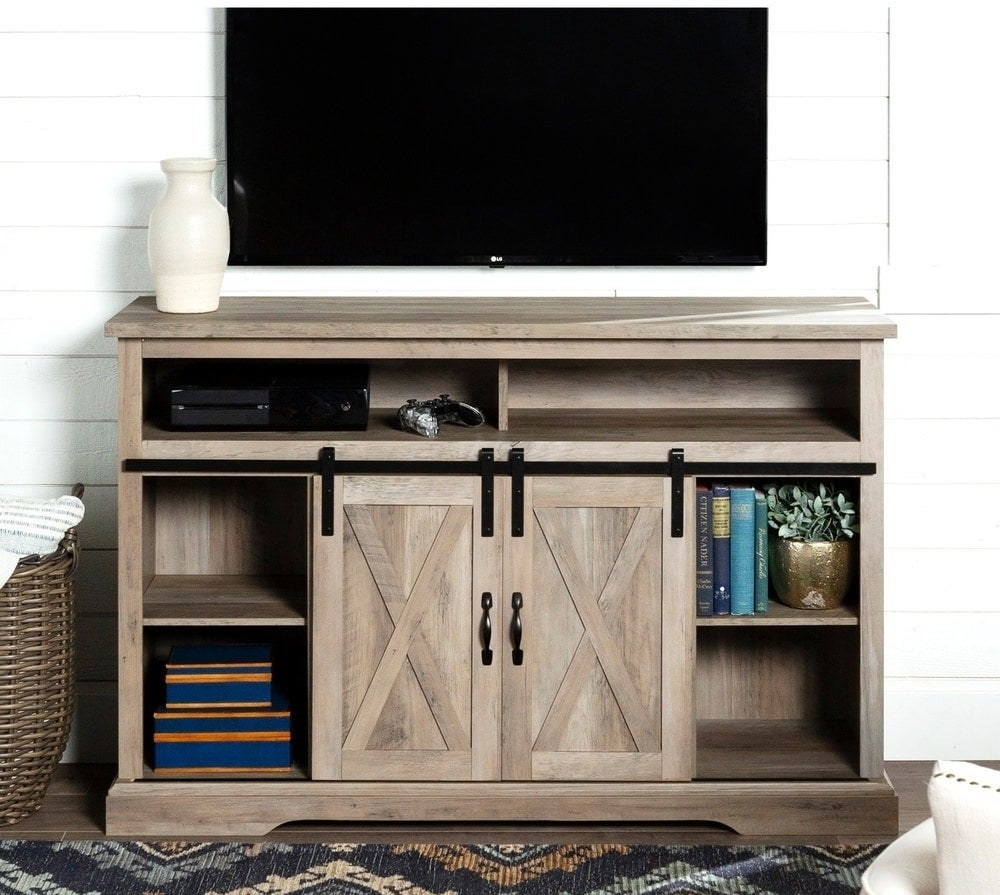 "The TV stand in the ""grey wash"" finish"