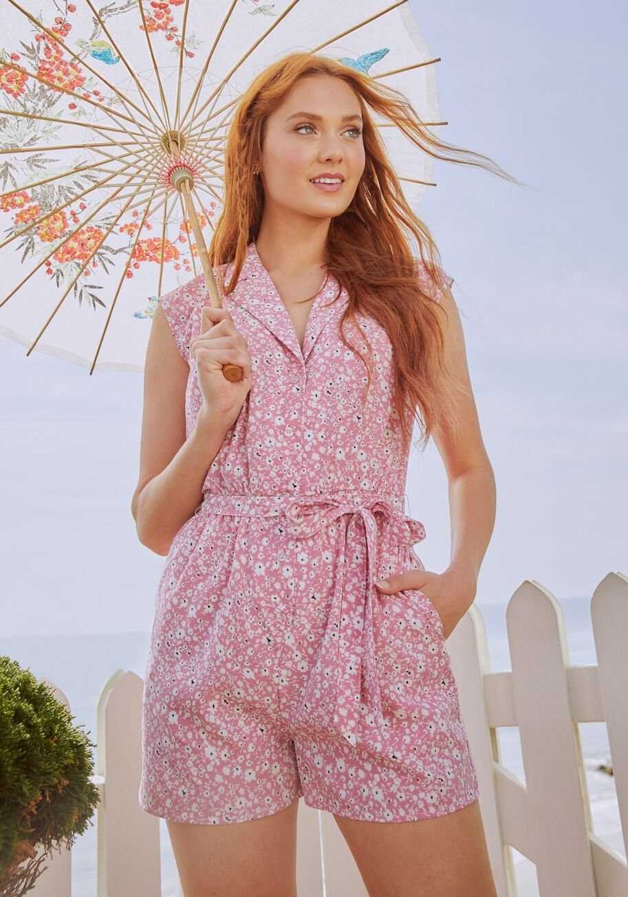 A model wearing the pink romper