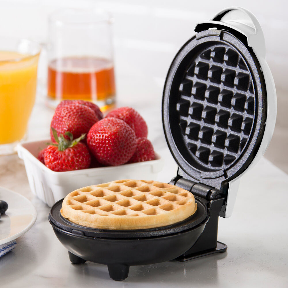round waffle in the maker about six inches wide