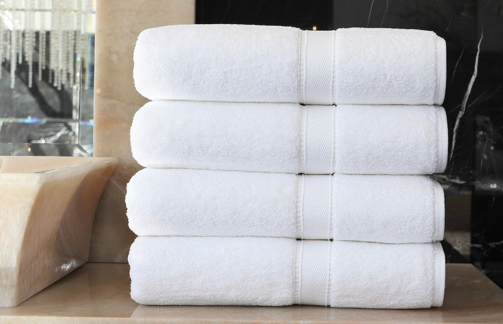 A stack of the four-piece bath towel set in white