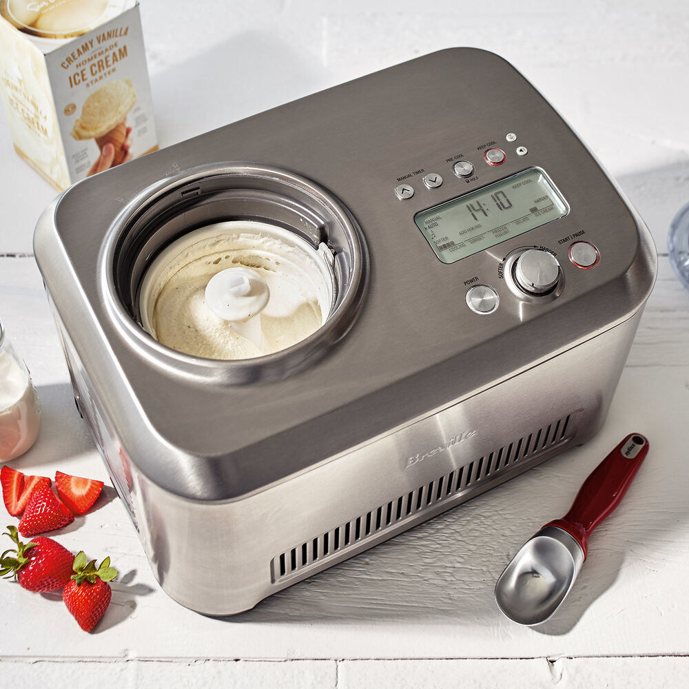 silver ice cream maker with a reservoir for churning, many buttons, and a screen