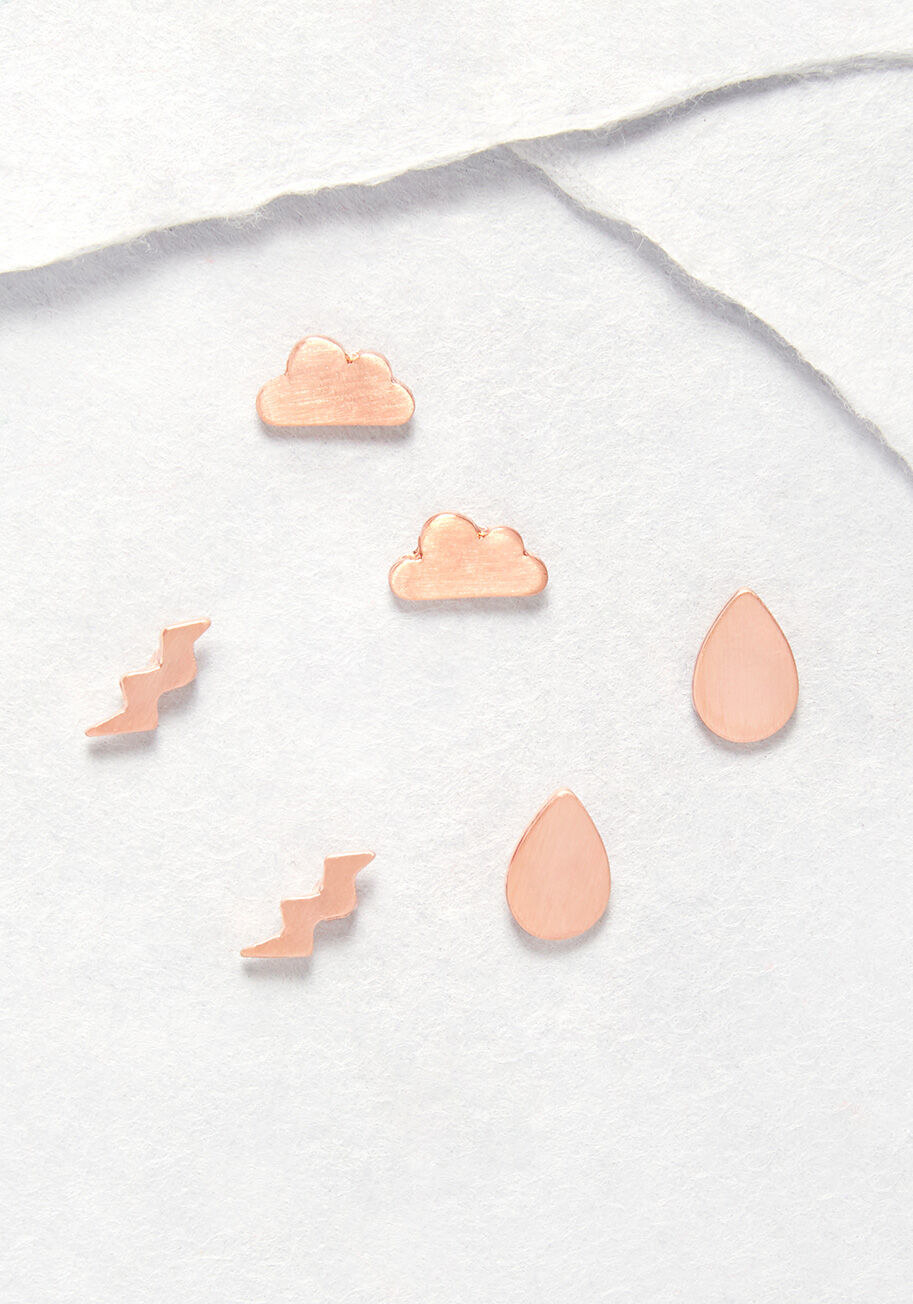 three pairs of earrings shaped like lightning bolts, rain drops, and clouds