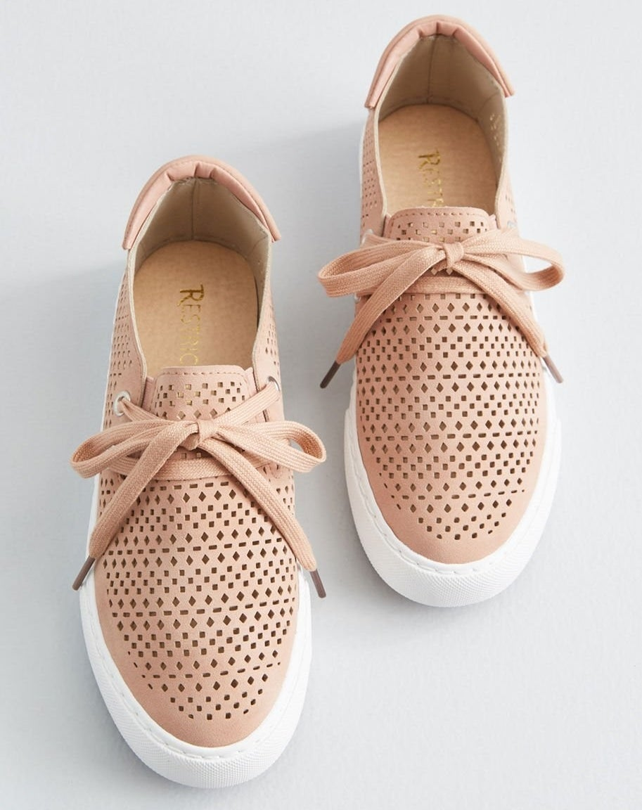 Tan/blush sneakers with a perforated diamond and square pattern and white soles