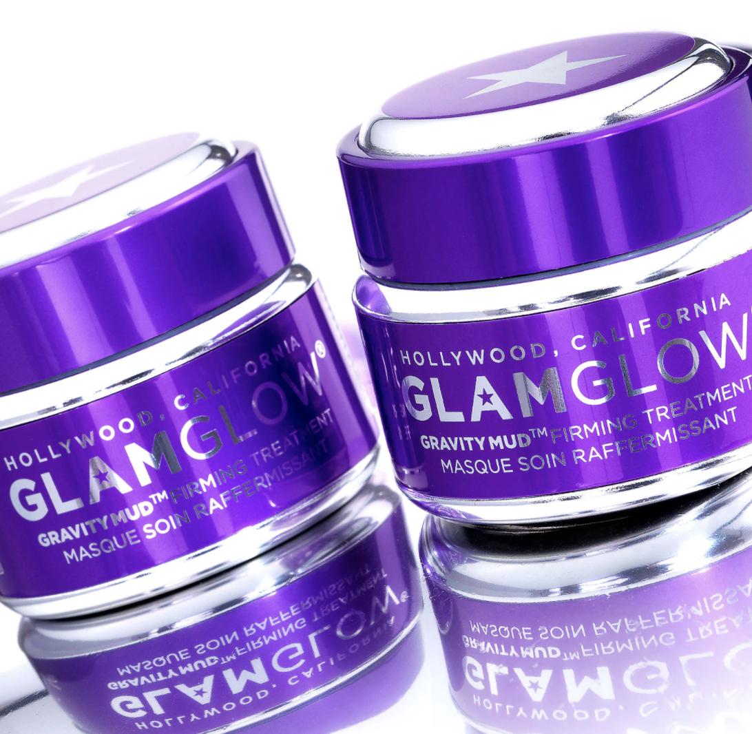 two purple and metallic jars of the glamglow gravity mud mask