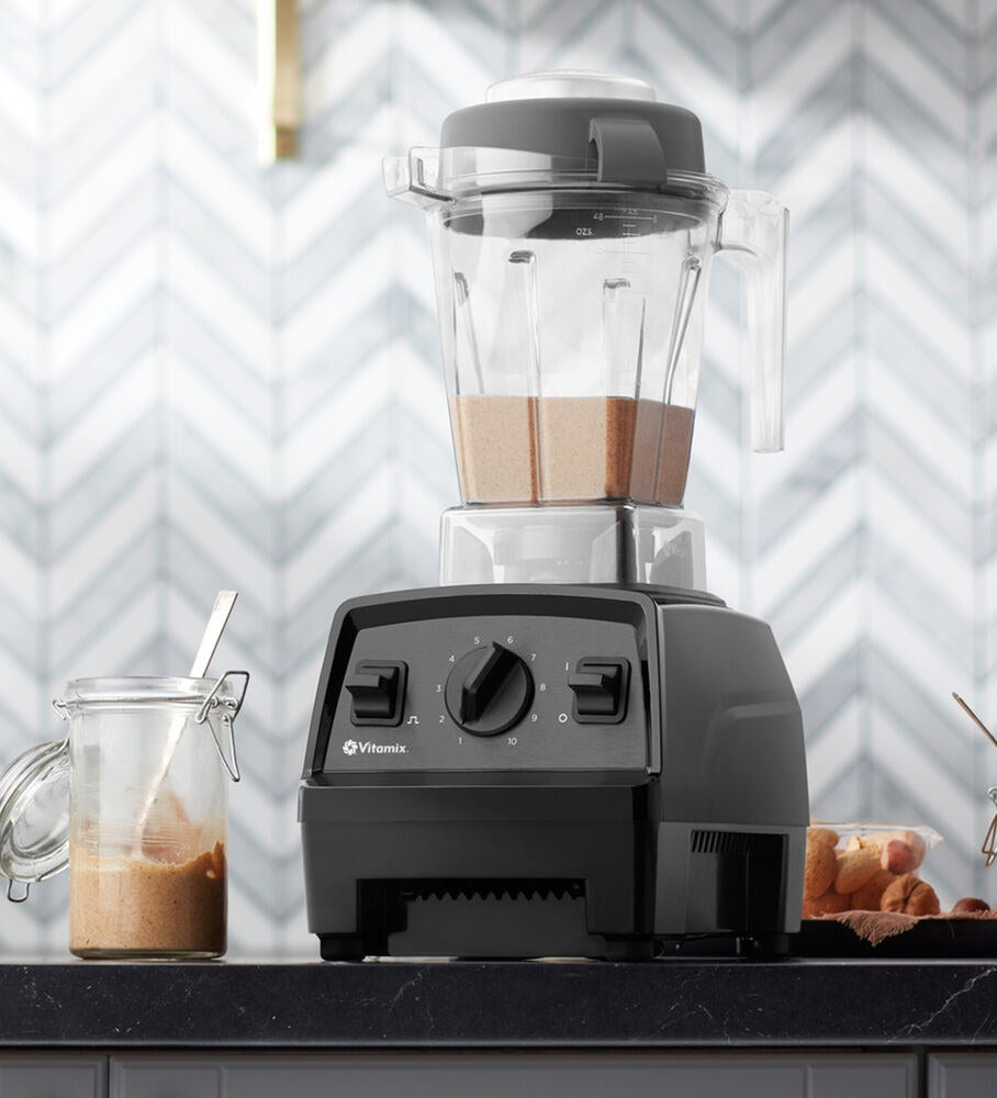 black vitamix with large base and speed dial blending nut butter