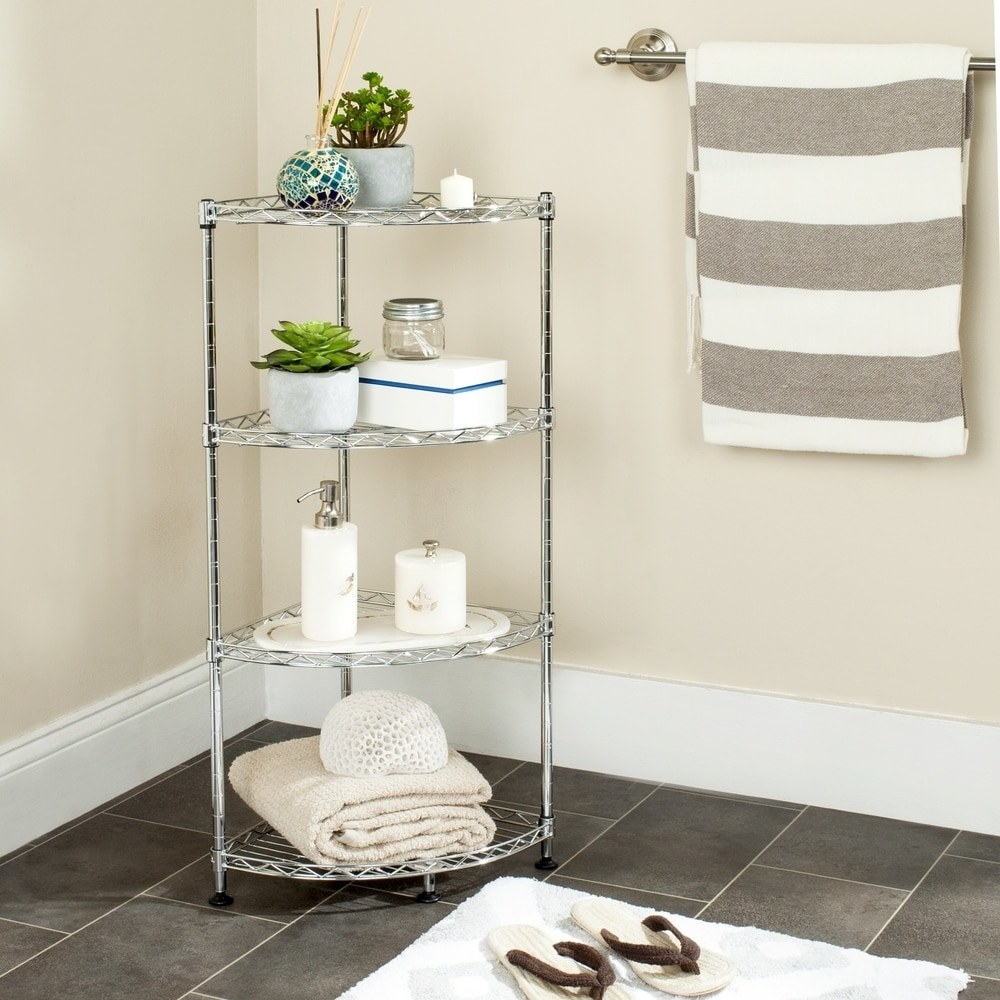 The tiered corner rack in a bathroom holding items like a towel and plants