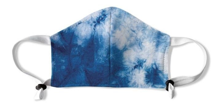 The blue and white tie-dye mask with white handles