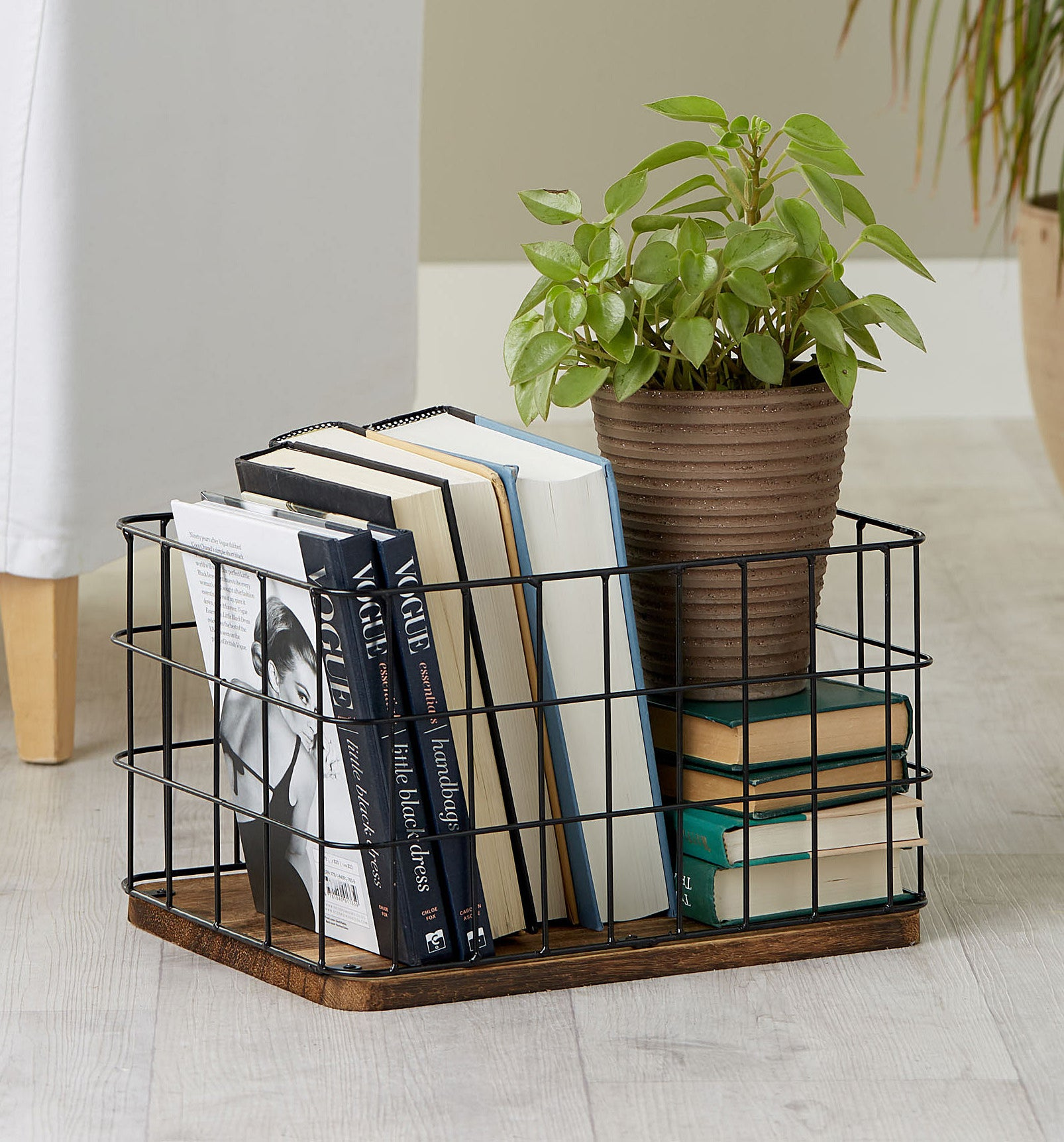A metal basket with books inside