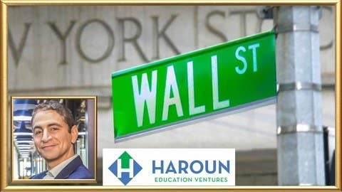 The Wall Street street sign next to a picture of Haroun