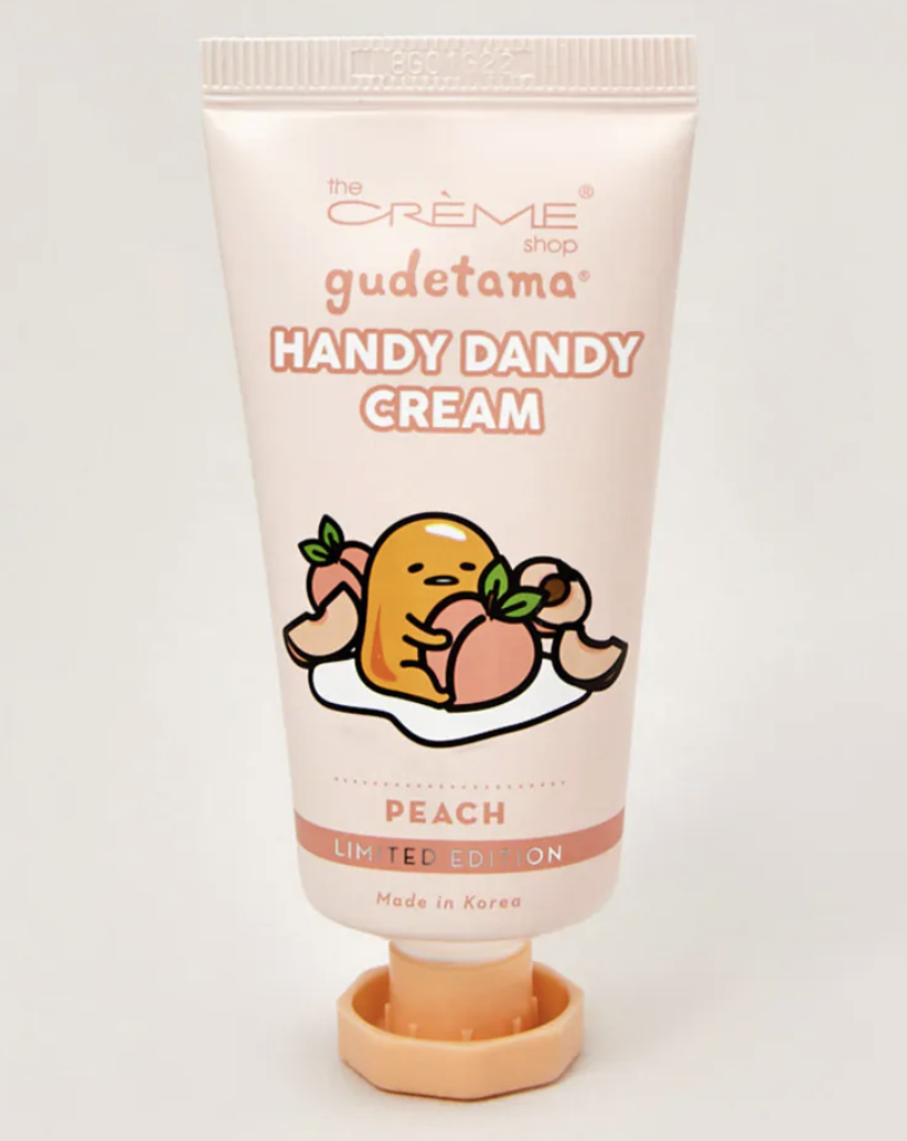 A travel-sized hand cream with the character Gudetama on it