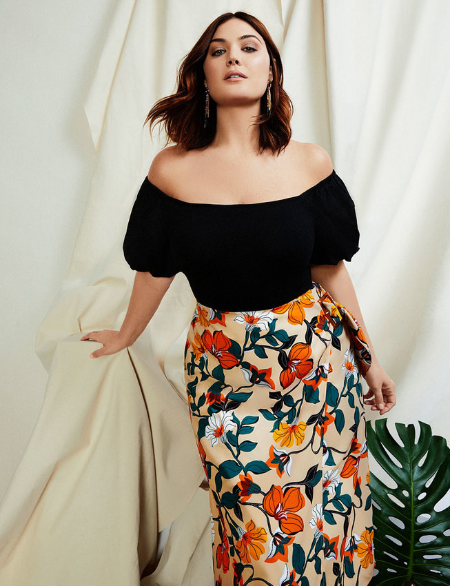 A model wearing the twill orange-and-white floral skirt with a black top