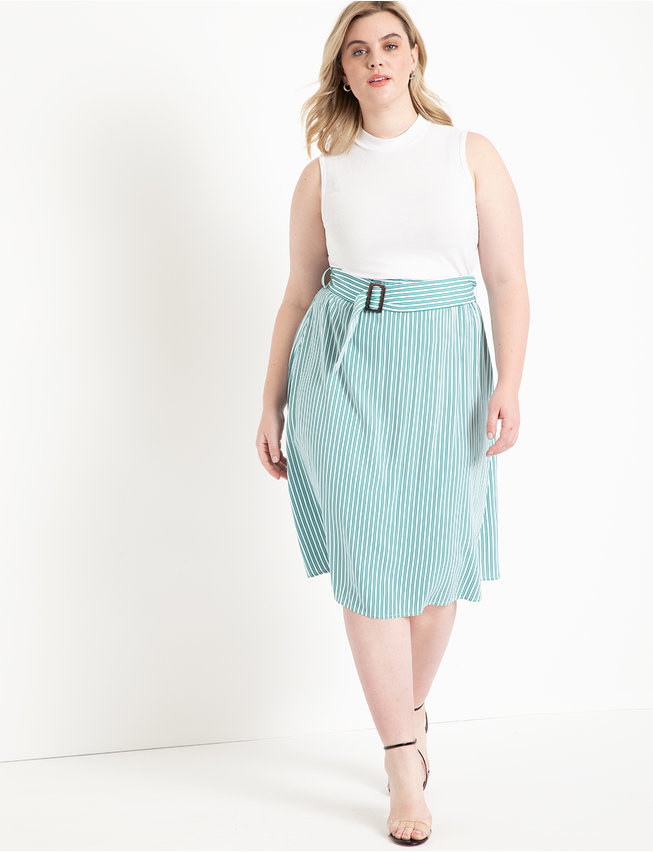 A model wearing the turquoise-striped skirt with black heels and a white sleeveless top