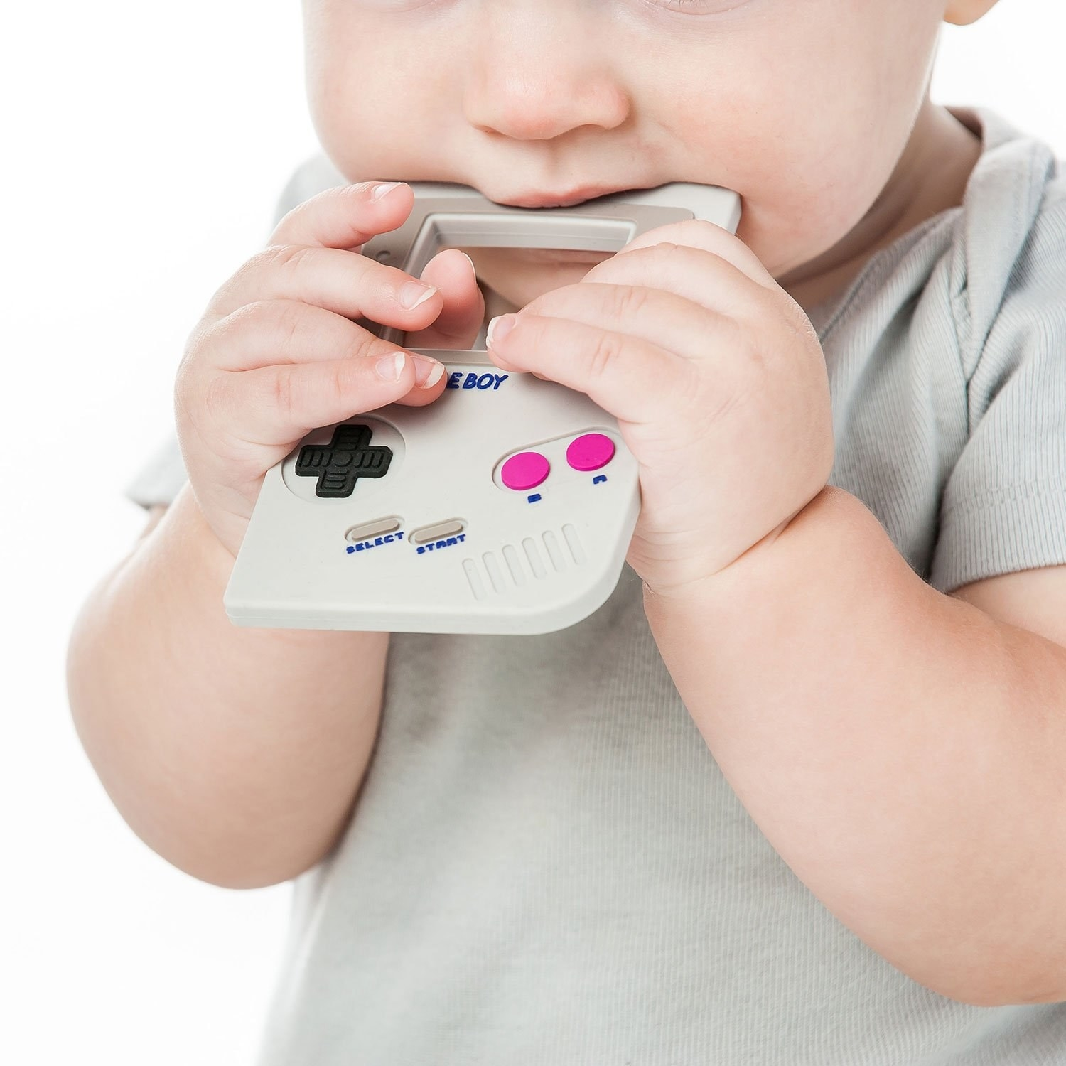 a baby bites on gray gameboy teether