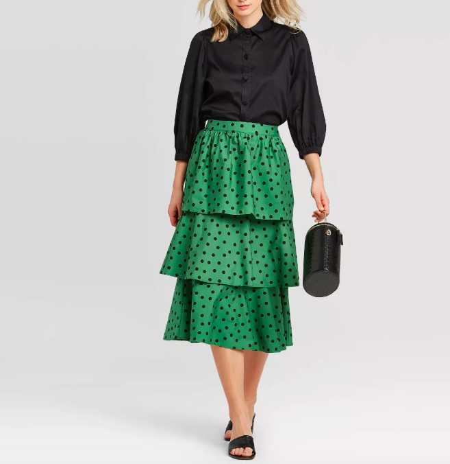 A model wearing the Who What Wear tiered ruffle midi skirt.