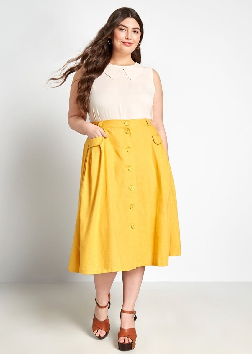 A model wearing the skirt in yellow