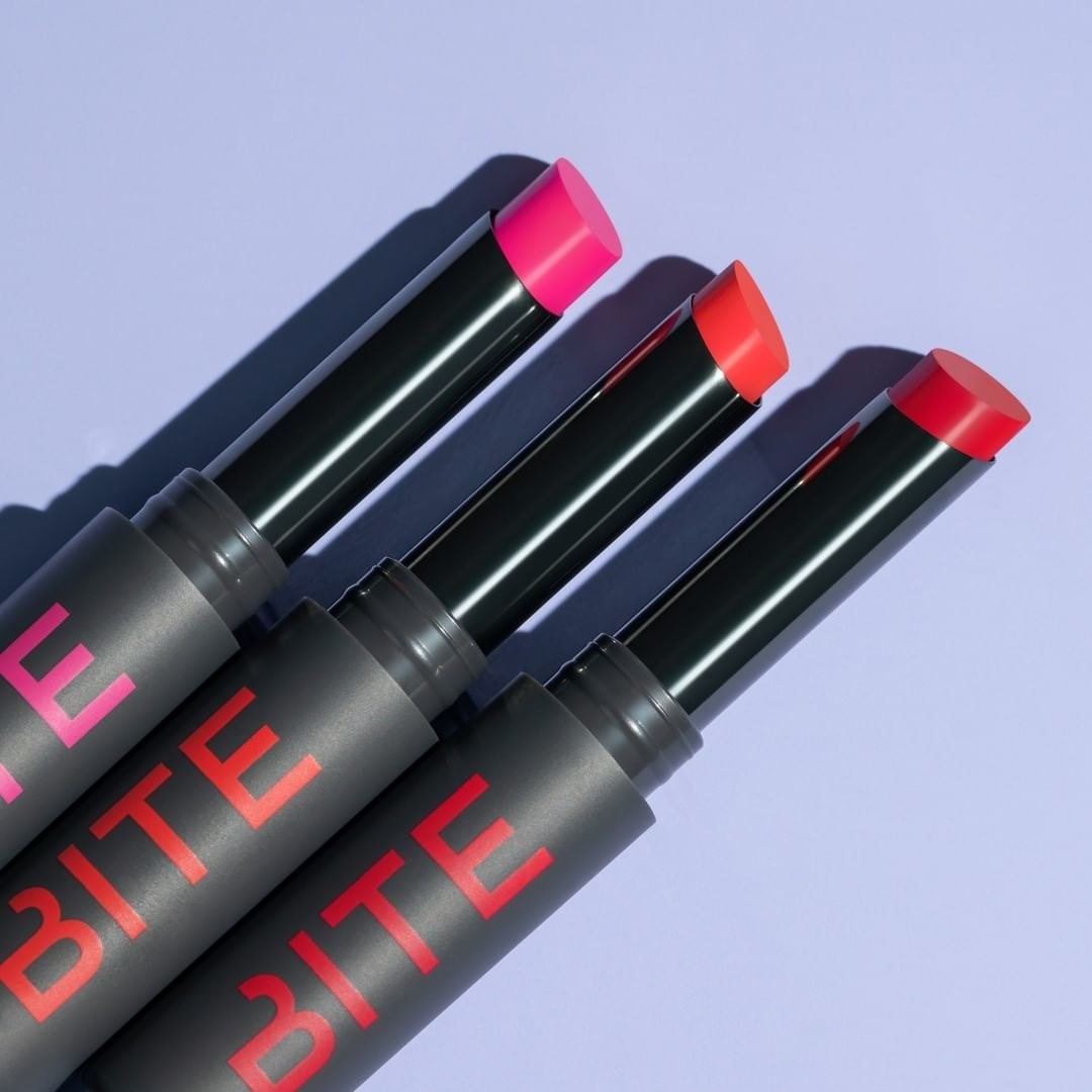 Three tubes of lipstick in a row