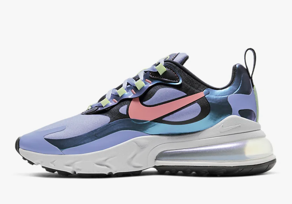 A Nike Air Max 270 React with a purple toe section, a light pink Nike logo, and reflective blue detailing throughout