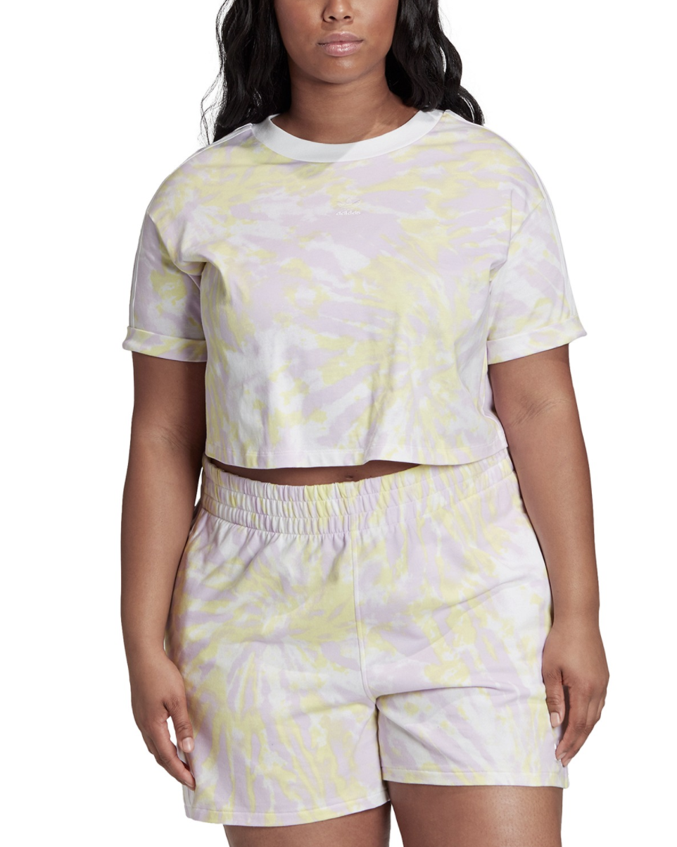 A Macy's model wears an Adidas light pink and yellow tie-dye crop top with matching shorts