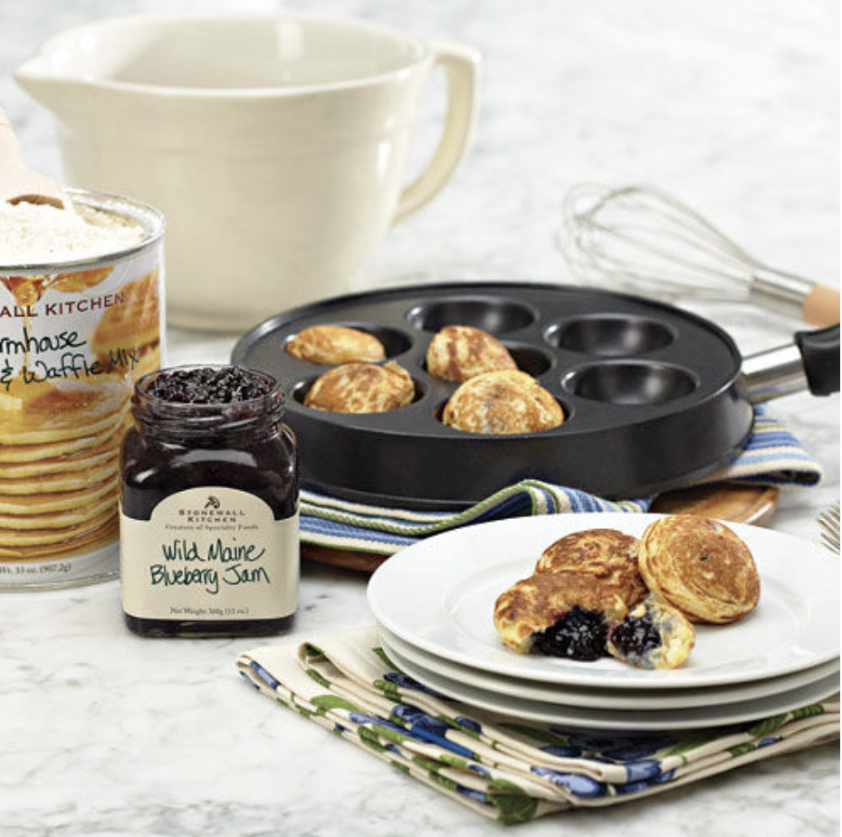 The items of the kit with cooked pancake puffs on display