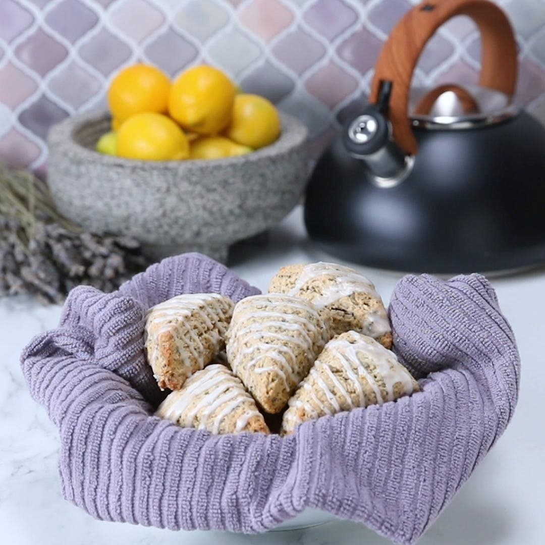 five lavender lemon scones on purple towel