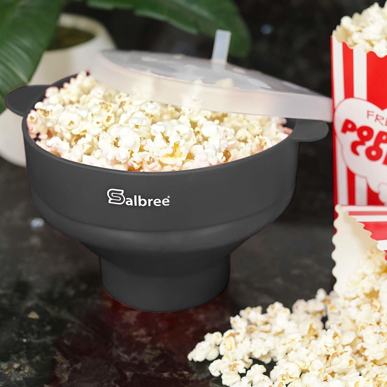 The bowl in gray full of popcorn