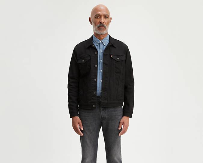 Model wearing trucker jean jacket in black