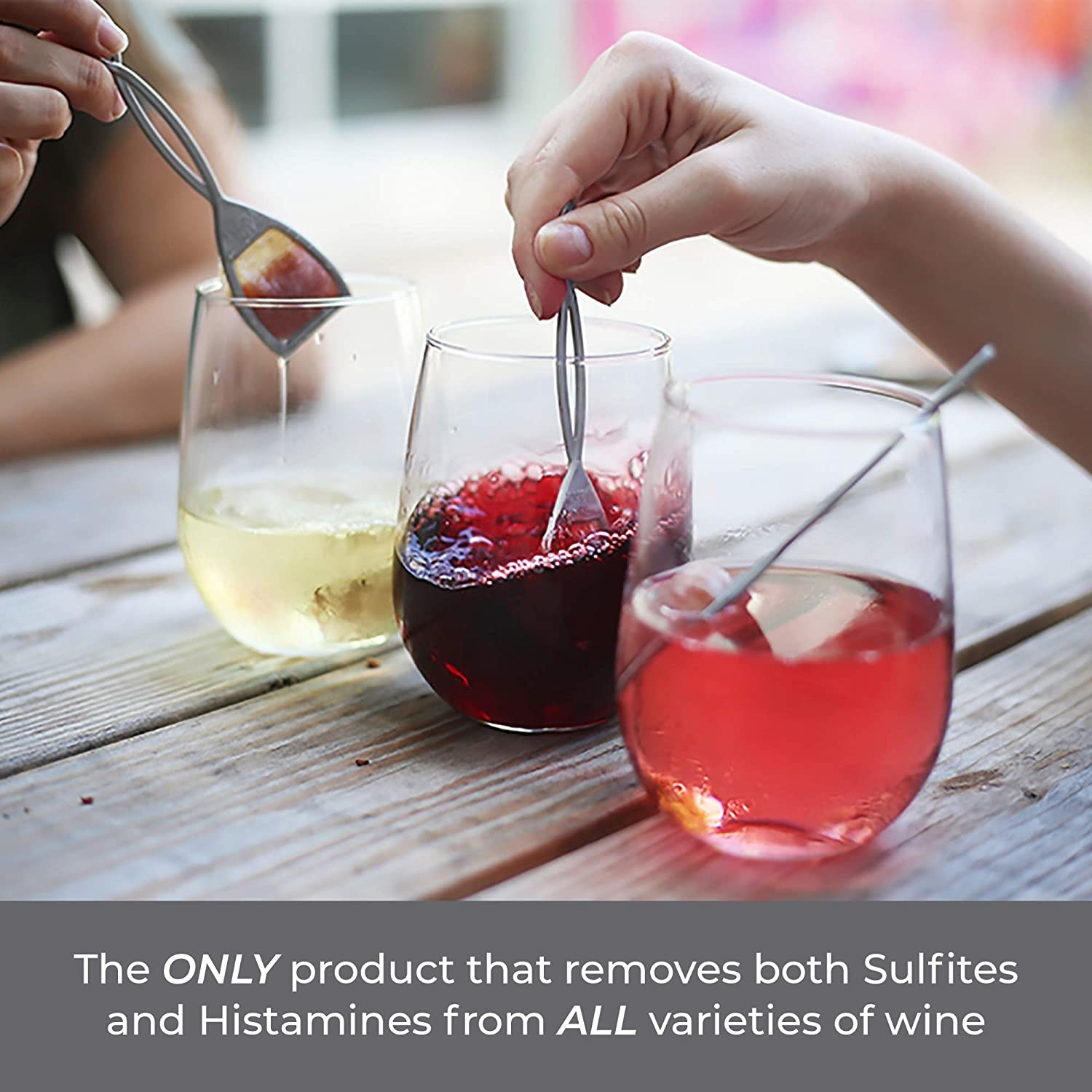 """three glasses of wine with the wands in them and an overlay note that says """"the only product that removes sulfites and histamines for all varieties of wine"""""""