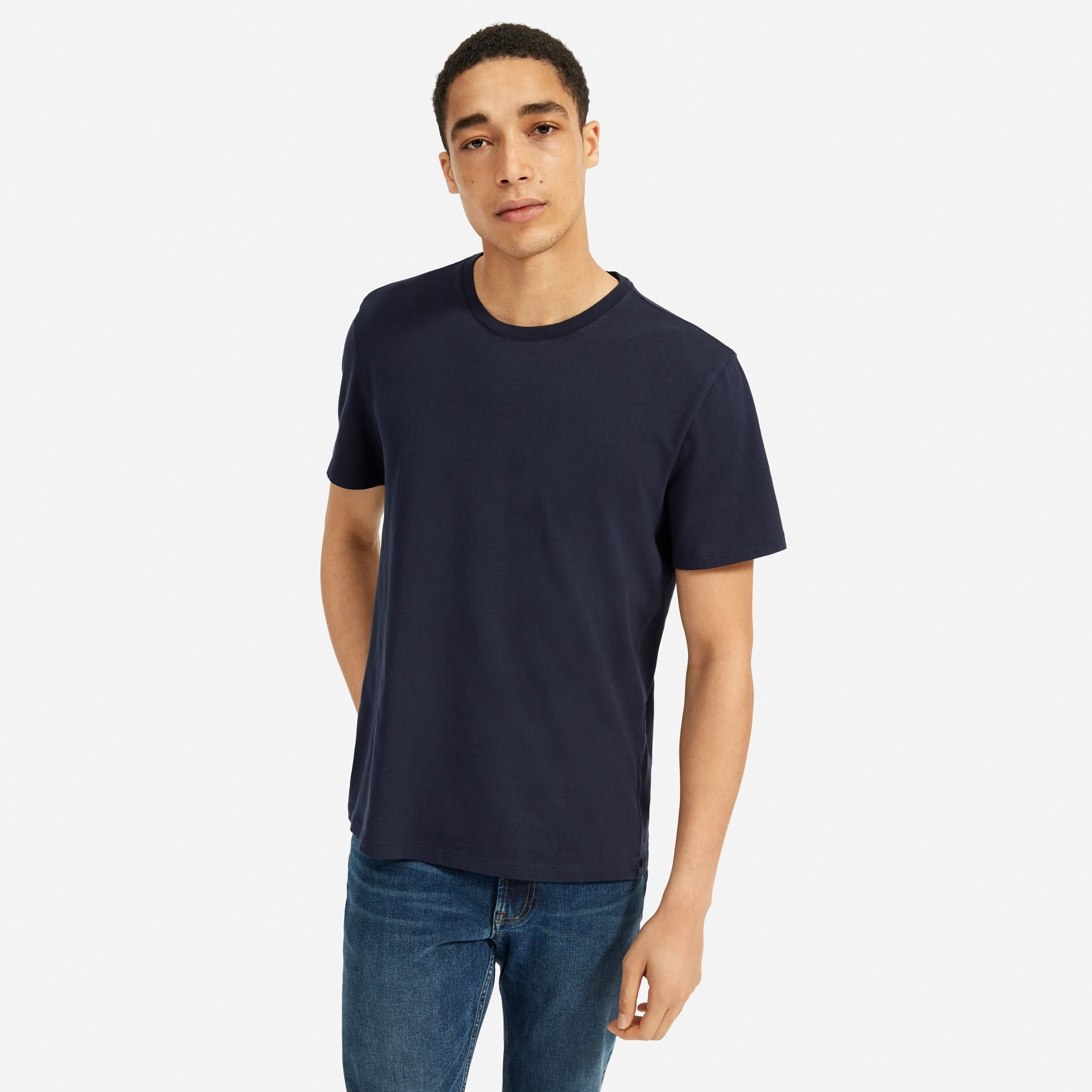 Model wearing the organic cotton crew in navy
