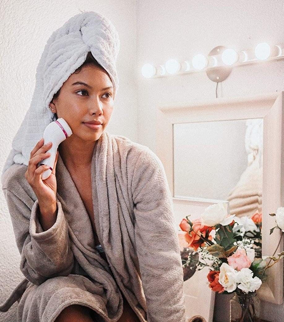 model using the white facial brush