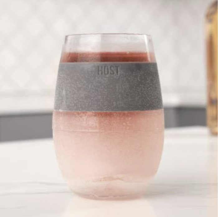 A transparent wine glass with freezable liquid in it