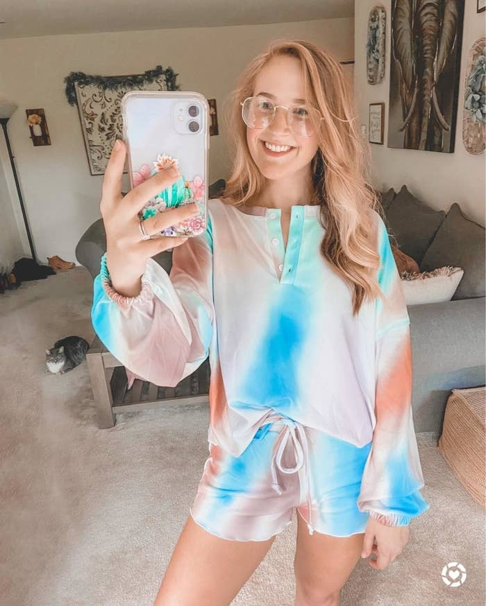 Reviewer wearing the set in blue, orange, and lavender tie-dye