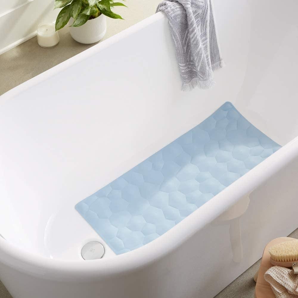 Alfombra azul antideslizante para regadera o tina